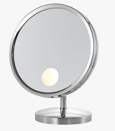 "Corazon Makeup Mirror is a 9"" diameter round countertop makeup mirror, with 25 watt incandescent lighting emanating from a small disk in the lower quarter, with 5X magnification, framed in polished chrome or brushed nickel, and cord connection."