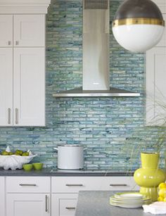 Fabulous backsplash! Love the addition of the bright yellow accents. Rachel Reider Interior Designs