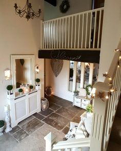 stone floor...fairy lights....inviting hallway converted barn