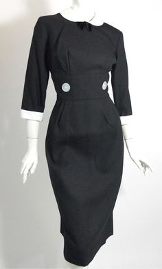 "Black linen weave rayon 50s dress with demure white peter pan collar and black velvet bow, overisized button accents at waist inset, white cuffs. Back metal zip, no label...no flaws. More images to come. 38"" bust, 28"" waist, 40"" hips, 16"" bodice, 41"" long    $195"