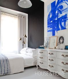 """I love the simplicity of this bedroom. In spite of the high contrast black and white color palette, it actually feels very calming. Mixing an antique chest and classic linen bedding with a white-painted floor and contemporary lighting is fresh and inviting."" — Jen Masseau, Assistant Design Editor 