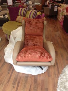 Customer own fabric used on the inside of our designer swivel chair which is covered in toffee leather