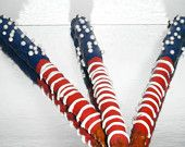 """AMERICAN FLAG Chocolate Covered Pretzel Rods.  Use chocolate coloring. Don't use """"dipping"""" chocolate for chocolate dipped pretzels…it's too thin to taste through the pretzel. For best results, use Belgian style Chocoley V125 Couverture Chocolate (available in bittersweet dark, semisweet dark, milk & white) OR use Chocoley Bada Bing Bada Boom Candy & Molding Formula Gourmet Compound Chocolate (available in dark, milk & white). Chocolate & chocolate colorings at Chocoley.com"""