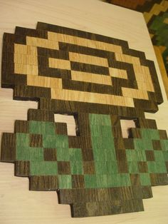 Flower pixelated wood sculpture... BUT what about as a cutting board?