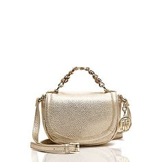 Tommy Hilfiger women's handbag. Our luxe little crossbody keeps your belongings demurely stowed in metallic Vachetta leather. Featuring a mini chain carry handle and adjustable crossbody strap for hands-free ease. <br>• Flap silhouette in leather with gold-tone hardware.<br>• Zip closure, interior pockets, lined, adjustable strap. <br>• Leather cleaner.<br>• Imported.<br>