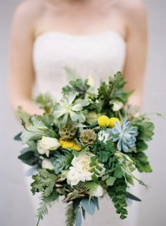 never thought about succulents in a bouquet... i really think they are pretty.