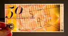 Currency design for New York City by Dave C Frankel.  When held to light, the security watermark is the city's map in different scales, determined by the denomination of the bill. The bills also change in size according to value.  Check all bills here.