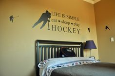 Hockey Themed Boys Bedroom Ideas With Neutral Yellow Walls And Awesome Black Wooden Bed Featuring Cool Hockey Quotes On The Wall 4288×2848 Boys themed bedroom ideas