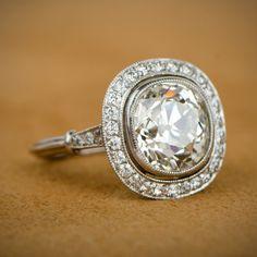 A 4.46 antique cushion cut diamond engagement ring.