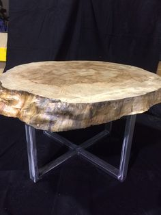 Table I made from a salvaged tree trunk. $350