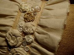 burlap & muslin pillow with buttons, vintage lace, ribbons & rosettes <3