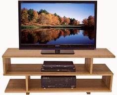 New York Contemporary TV Stand #3 in natural cherry.  Perfect stand to hold your flat screen TV! Chic and modern addition to your living room.