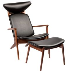 GRANNY lounge chair in black art. leather with stained walnut legs