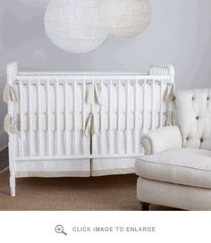 Mom look! @Franleses with cream pearl sheet! Annette Tatum Crib Bedding Simplified Nursery in Creme Crib Set | Polka Dot Peacock