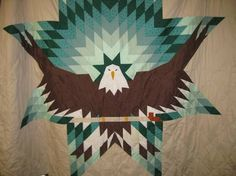 Eagle Star with Pipe quilt. Quilts are designed and quilted by Dakota women of the Crow Creek rez.