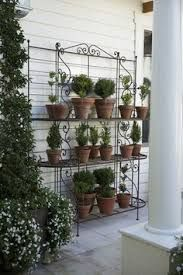 Yard Art Bakers Rack Google Search Garden Containers Topiary