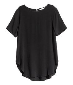 Check this out! Straight-cut blouse in crêped woven fabric. Opening at back of neck with pearlescent button, short sleeves, and rounded hem. Slightly longer at back. - Visit hm.com to see more.