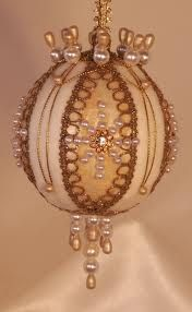 Heirloom Victorian styled Christmas tree ornaments mint and gold on this beautiful ornament.