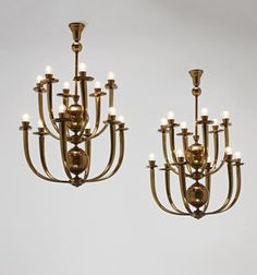 PHILLIPS : UK000310, Unkown Designer, Pair of monumental twelve-arm chandeliers, from the Rizzoli headquarters, Milan