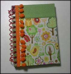 Caderno pequeno encapado co  tecido