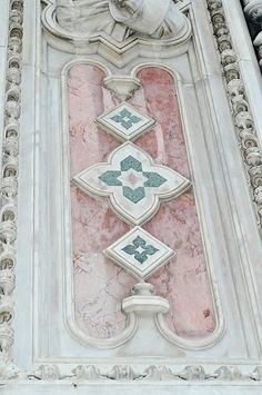 The beautiful pink and green marble of the Duomo
