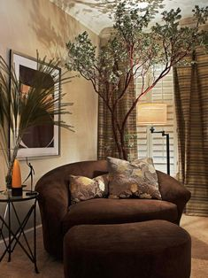 This neutral, contemporary living room has a brown suede chair, ottoman and striped curtains on HGTV.com.