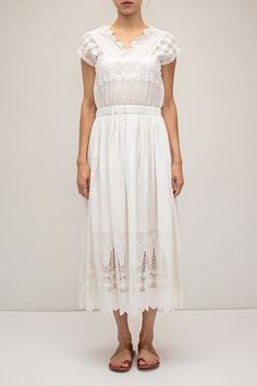 """- 100% Cotton Voile - Scalloped neckline & hem - Elastic waist - Hidden lining - Eyelet embroidery - Color: White - Model is 5'9"""" and wears a US 2."""