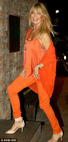 dressed for the tropics: orange only outfit worn by Goldie Hawn