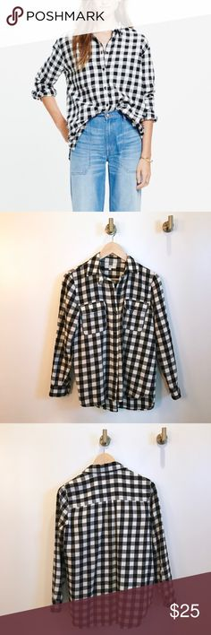 Madewell flannel shirt b/w buffalo check Comfy and cute! Worn a good amount but still in great used condition! No tears, stains, or flaws. Product details: An oversized flannel version of our favorite tomboy button-down shirt with a cool slit shirttail hem. An easy shape in timeless black-and-white buffalo checks.    Slightly oversized. Cotton. Machine wash. Import. Item E4760. Madewell Tops