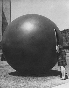 Enquire+Within  woman+looks+inside+split+sphere