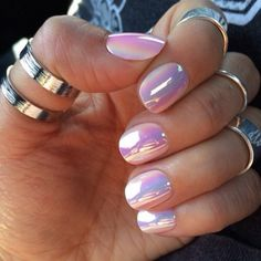 Pink holographic nails and silver band rings