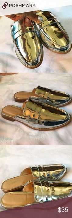 Silver mirrored loafer slides Super cute and trendy mirrored loafer slides on a size 8. Never been worn Shoes Flats & Loafers