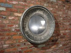 Round Metal Wall Mirror - http://www.hudsongoodsblog.com/round-metal-wall-mirror/