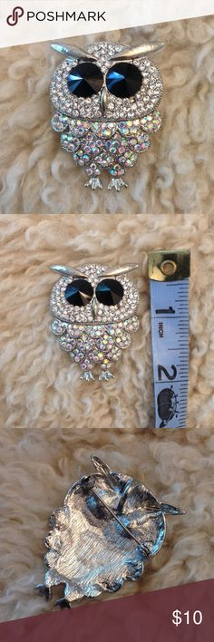 Rhinestone owl brooch This little rhinestone owl brooch is a hoot! He's about two inches long and had both a pin clasp and a hoop to be worn as a pendant on a necklace. Missing a single tiny rhinestone but you can't tell unless looking super close. Jewelry Brooches