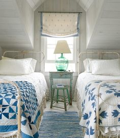 Coastal blues and greens enliven century-old quilts in Pinwheel (left) and Bear's Paw patterns that dress the antique wrought-iron beds in the bedroom of this Nantucket cottage. The new rag rug was handwoven by area artisans at the Weaving Room, and the demijohn lamp hails from a nearby antiques shop. Bright Idea: Loosen up a traditional bedroom with mismatched quilts.   - CountryLiving.com