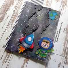 Hidden Galaxy Slider - My son was so excited about the hidden slider mechanism that he wanted to create a Galaxy card using this technique and what better stamp sets for this project than the Gerda Steiner Designs Blast off and Alien Invasion? https://littleartcottage.blogspot.com/2018/07/hidden-galaxy-slider.html #gerdasteinerdesigns #gsdstamps #lawnfawn #kuretakegansaitambi #watercolors #slider #alcoholmarker #nuvo #handmade #cardmaking #stamps #stamping