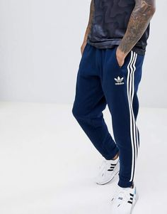 Shop adidas Originals Joggers In Navy at ASOS. Adidas Joggers Outfit, Jogger Outfit, Adidas Tracksuit, Adidas Pants, Adidas Men, Sweatpants, Mens Jogger Pants, Latest African Fashion Dresses, Fashion Pants
