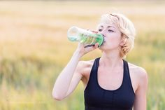 Fitness woman drinking water by kasto80