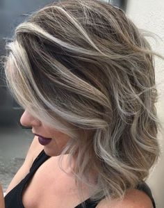 Shadow roots are all the rage for fall hair color. We like this one by Mark Anthony's Salon stylist Stacey.