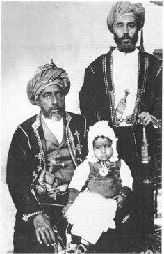 Sultan Faisal bin Turki bin Said of Muscat and Oman carrying his grandson Sultan Said bin Taimur