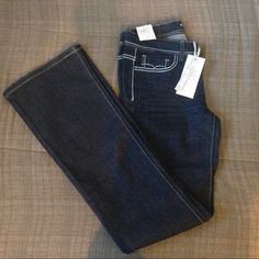 NWT. Dark Demin Boot cut jeans NWT. Dark denim boot cut jeans. Has a cute design on the back pockets. Size: 1 x 32. Condition: Brand new with all the tags. Macy's Jeans Boot Cut