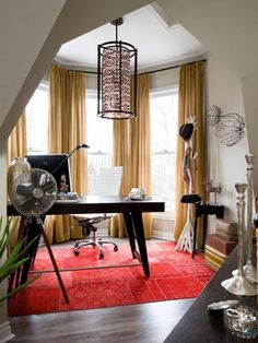 Office space with bold accent rug and excellent architectural features