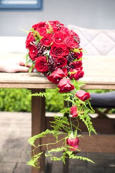 Trailing wedding bouquet with prestige red roses, viburnum berry and asparagus fern. Asparagus Fern, Flowers Delivered, Gift Baskets, Red Roses, Wedding Bouquets, Beautiful Flowers, Berry, Floral Wreath, Wreaths