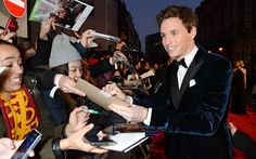 Blue Velvet at the BAFTAs - Eddie Redmayne signs autographs outside the Royal Opera House