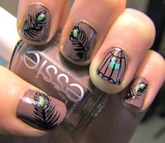 feather nails with bird cage