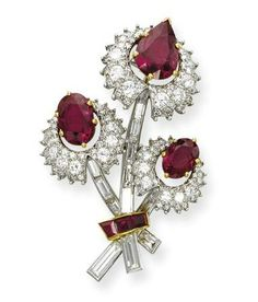 A RUBY AND DIAMOND FLOWER BROOCH, BY CARTIER   Designed as a thistle spray, the pear and oval-shaped ruby pistils with brilliant-cut diamond petal surround, to the baguette-cut diamond stems and calibré-cut ruby ribbon, circa 1960, 4.8 cm long, in a Cartier red leather case  Signed Cartier: