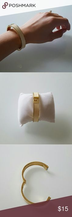 Cream and Gold Clasp Bracelet Magnetic clasp closing bracelet. Cream and gold color.  Very simple and elegant New York & Company Jewelry Bracelets