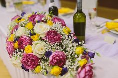 Wedding bouquet in beautiful spring colours. Pink yellow violet head table centerpiece. weddinx.sk