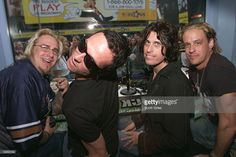 Scott Weiland and Dean DeLeo of Stone Temple Pilots with K-Rock DJ's Crazy Cabbie, on left, and Cane on right during an interview in the window of the MTV store in Times Square in New York City. Photo by Scott Gries/Getty Images Scott Weiland, Stone Temple Pilots, Mtv, Rock Bands, Dean, Times Square, Interview, Window