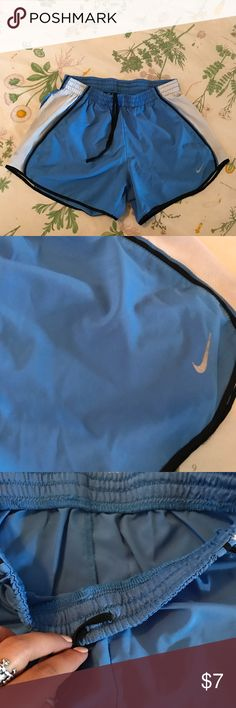 small blue Nike running shorts Blue nike shorts. The built-in underwear has been cut out (shown in photo). Size Small. No stains. ♥️♥️currently selling nearly everything I own & putting it towards post-grad travel funds and charity. make a reasonable offer or bundle and I will happily accept & show love to your page! Thanks for stopping by & happy shopping!🛍💌 Nike Shorts